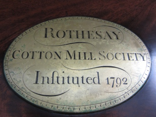 Brass plaque from the cotton mill society box.